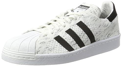the latest 8ee32 50b3b adidas Superstar 80S PK W, Zapatillas de Deporte para Mujer, Blanco  (Ftwbla Negbas   Griuno), 42 EU  Amazon.es  Zapatos y complementos