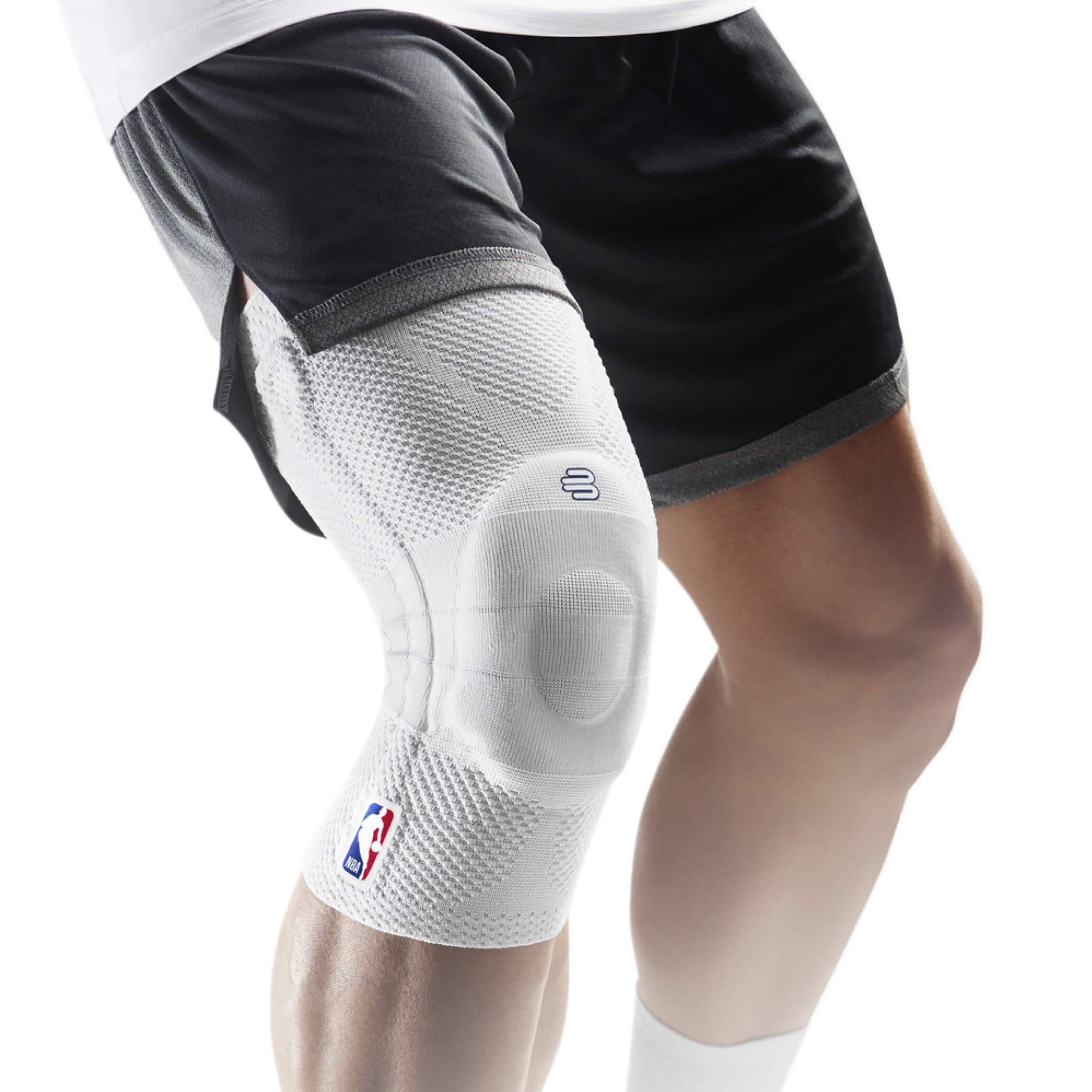 Bauerfeind GenuTrain NBA Knee Brace - Basketball Support with Medical Compression - Sleeve Design with Patella Pad Gel Ring for Pain Relief & Stabilization (White, S) by Bauerfeind (Image #1)