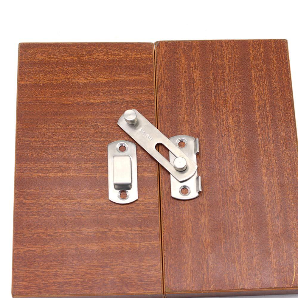 La puerta del cerrojo de la puerta de acero inoxidable se cierra en la cerradura de la puerta de seguridad