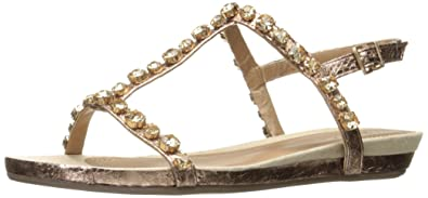 606e18d7cf458 Kenneth Cole REACTION Women s Lost Catch Flat Gladiator Open Toe Sandal  with Gemstone Accents-Metallic