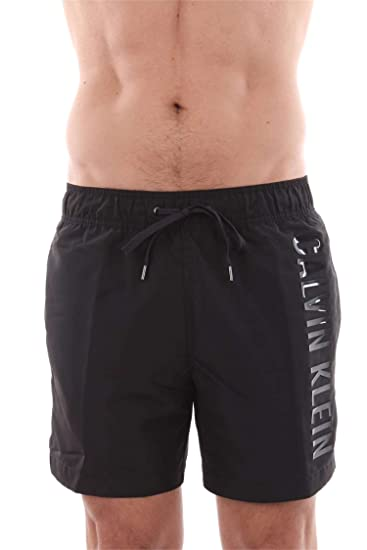 6c11bcbf67 Calvin Klein Black Embossed Swim Shorts: Amazon.co.uk: Clothing