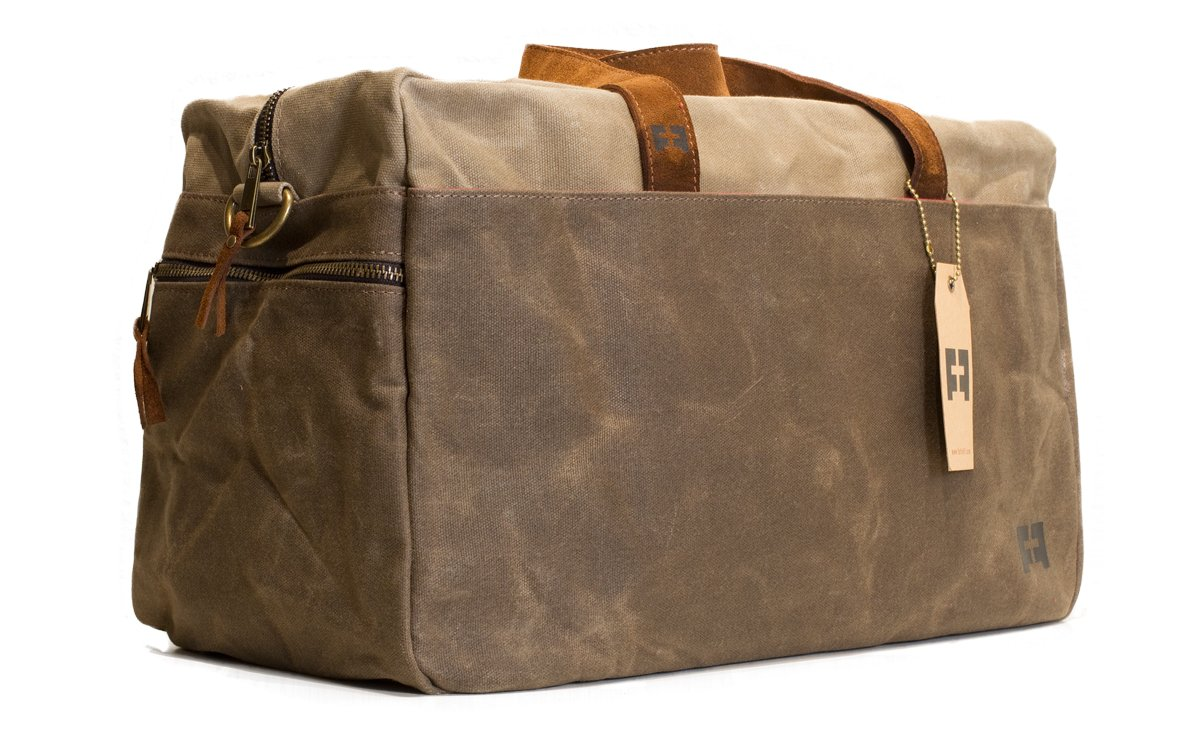 the WHITMAN WEEKENDER DUFFEL | 16 ounce hard waxed canvas duffel bag with suede leather handles