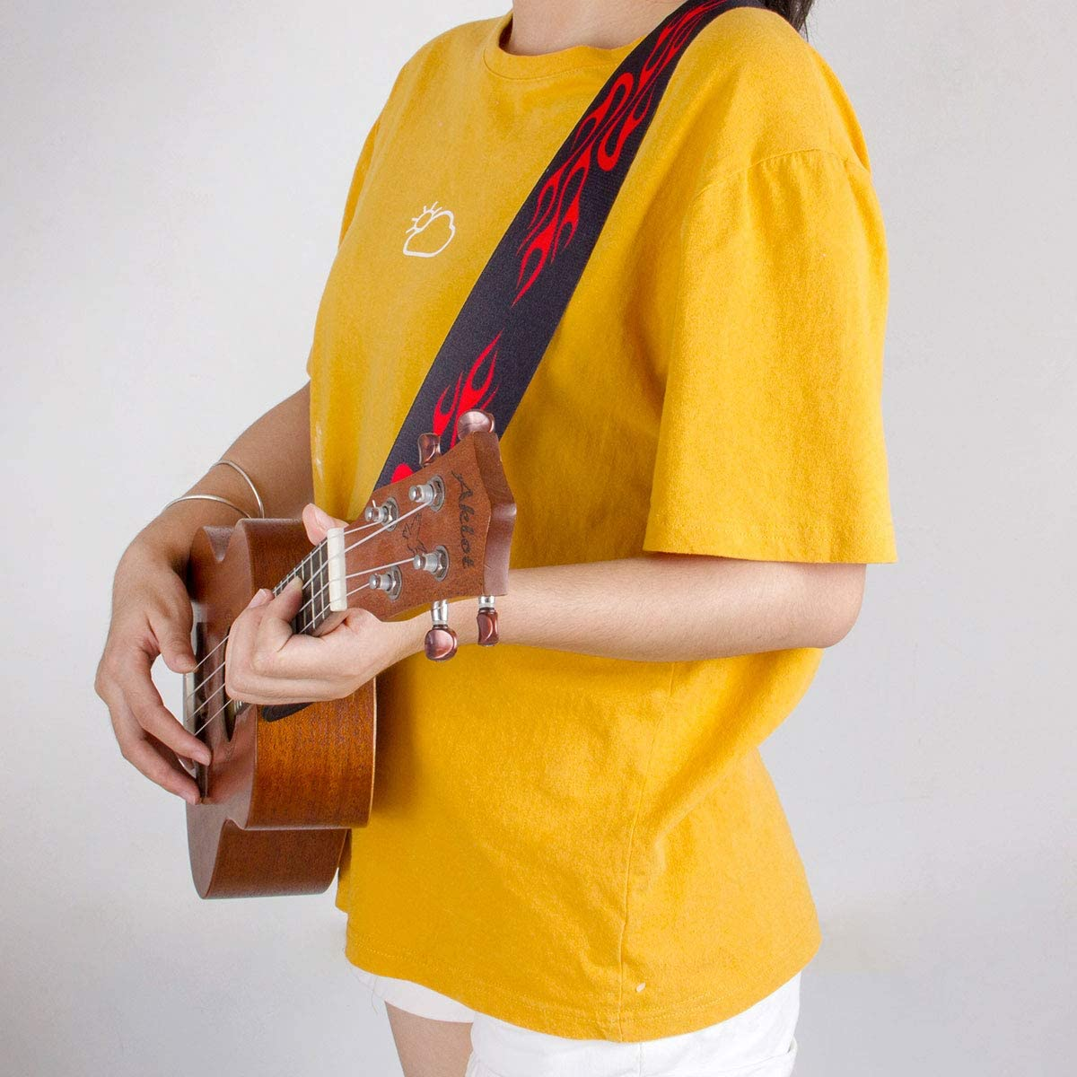 Lotmusic Sangle guitare r/églable en cuir Motif flammes rouges