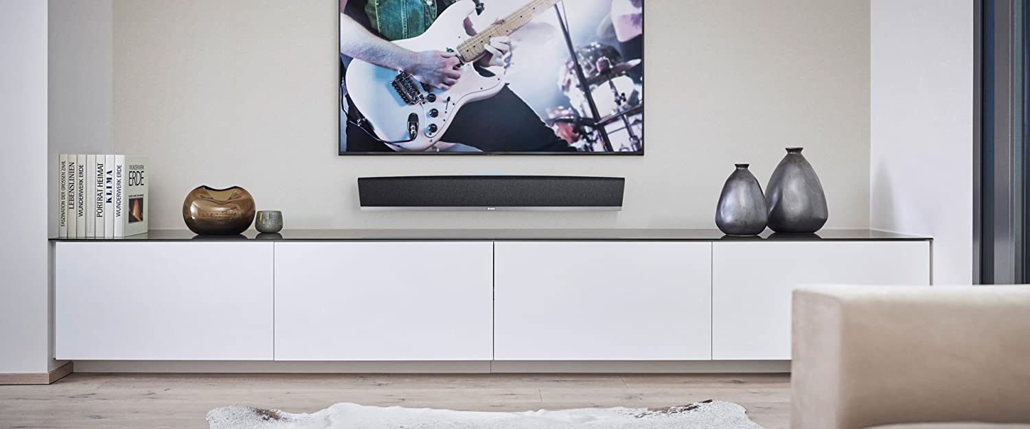 Soundbar Home Theater Package in Black Denon HEOS Bar Powered Wireless Sound Bar HEOS Music System with 4K HDR Passthrough and Bluetooth with HEOS Wireless Subwoofer System