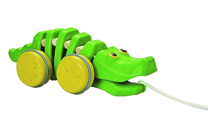 Plan Toys- Cocodrilo bailarín (5609): Amazon.es: Juguetes y juegos