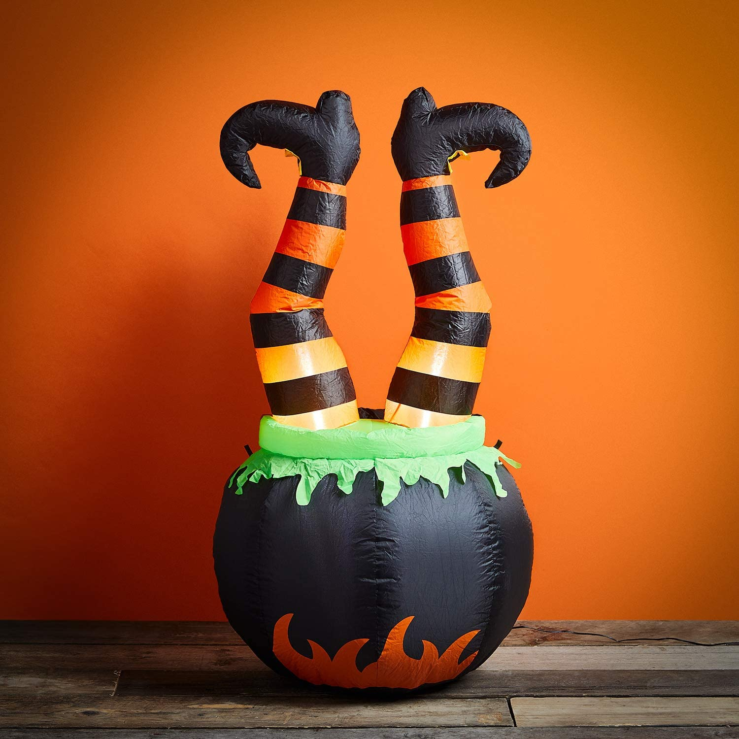 Amazon Com Lights4fun Inc 4ft Inflatable Witches Legs In Cauldron Halloween Decoration With Built In Led Lights Garden Outdoor