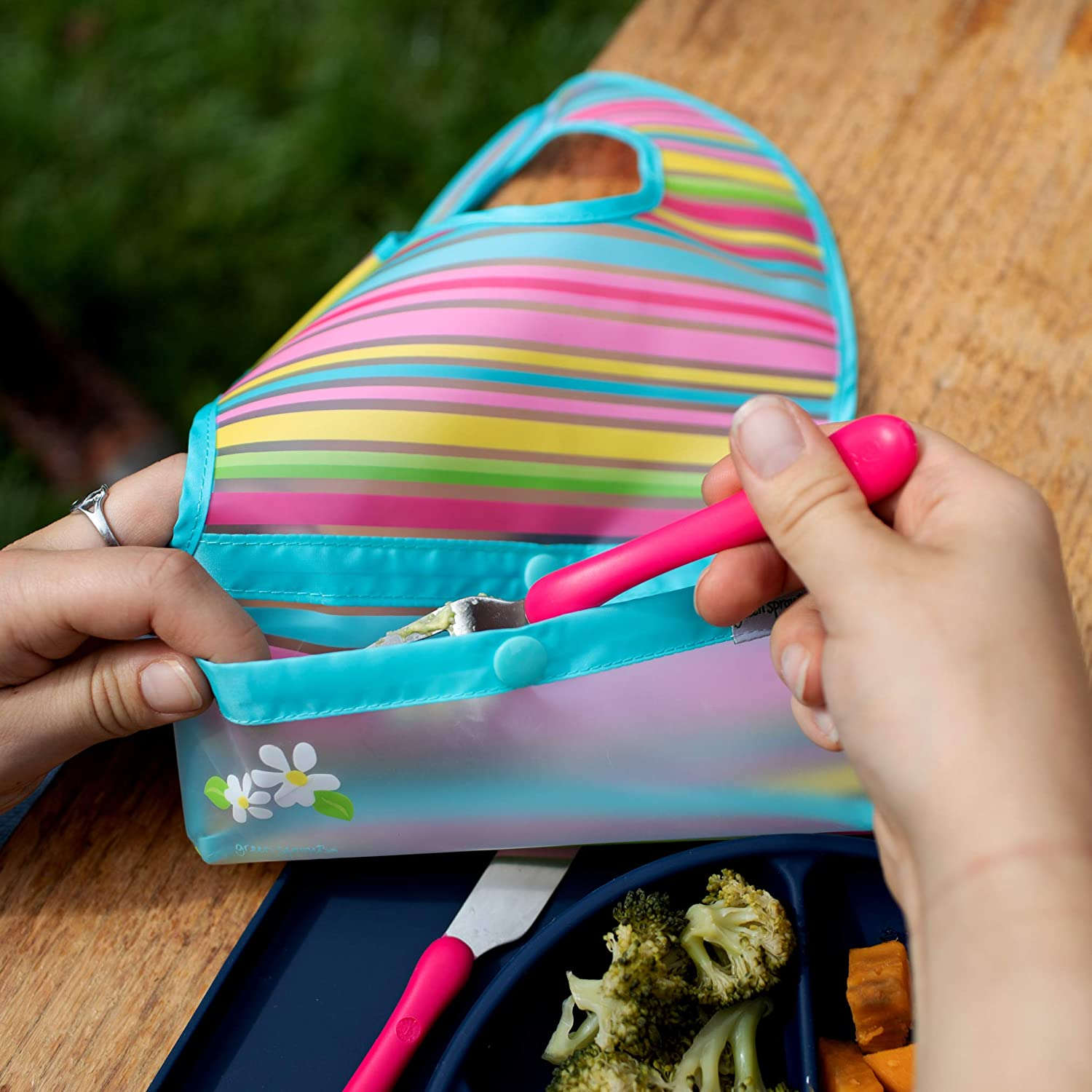 Flipped pocket stays extended to catch spills Neatly rolls up for mess and utensil storage Easy clean |  Waterproof protection for messy eaters green sprouts Snap /& Go Wipe-off Bibs 3 pk