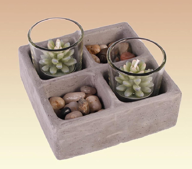 Ciotola in poliresina tipo pietra con sassi e bicchierino con due candele tipo piantina grassa; cm 13, 5*13, 5*4 in scatola regalo ou