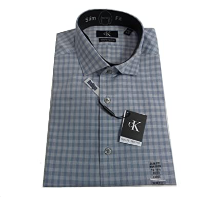 58f707a2 Calvin Klein Slim Fit Non Iron Dress Shirt Indigo Checks at Amazon Men's  Clothing store: