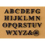 press in letters stone concrete stamps uppercase traditional typeface