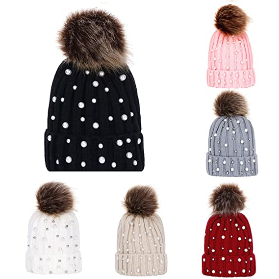 d862ee81b44 BSGSH Women s Winter Slouchy Knitted Winter Hat Faux Pearl Beading Faux Fur  Pom Beanie Hat (Black) at Amazon Women s Clothing store