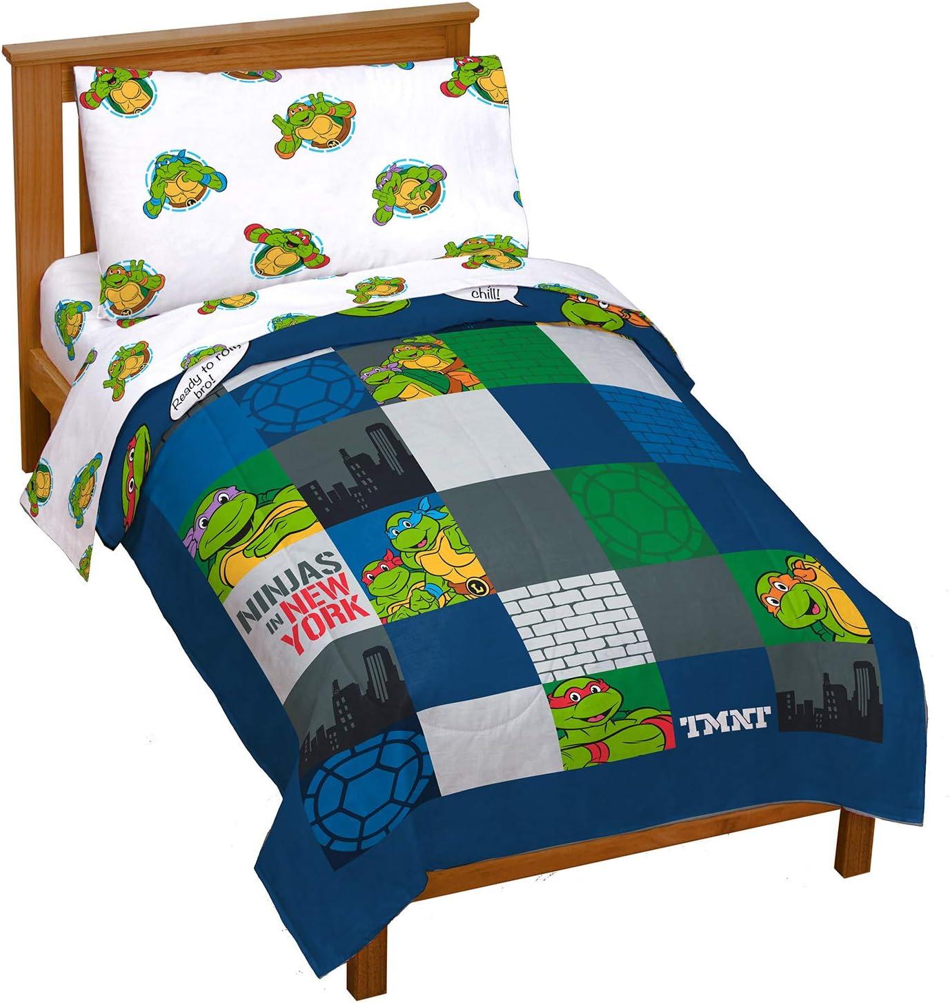 Nickelodeon Teenage Mutant Ninja Turtles NY Ninjas 4 Piece Toddler Bed Set - Includes Reversible Comforter & Sheet Set Bedding - Super Soft Fade Resistant Microfiber (Official Nickelodeon Product)
