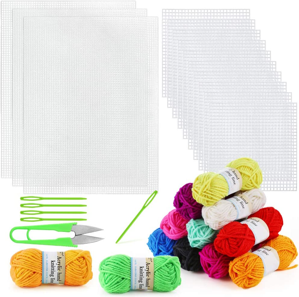Colored yarns, different needles, and sheets for sewing -- teaching kids sewing