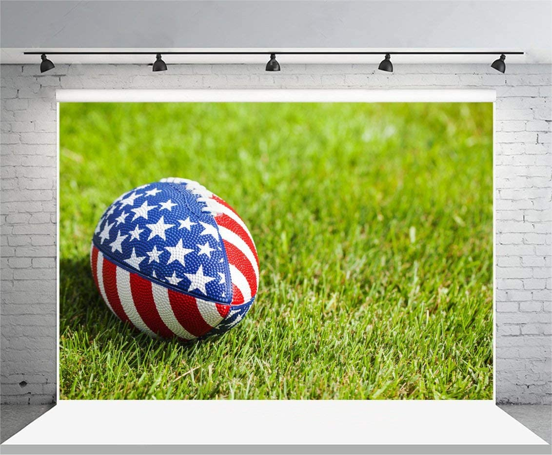 Independence Day Background GoEoo 7x5ft Vinyl Photo Backdrop Photography Rugby Ball Stars and Stripes Pattern Design Grass Field Souvenir Holiday Party Birthday Children Girls Adult Portrait