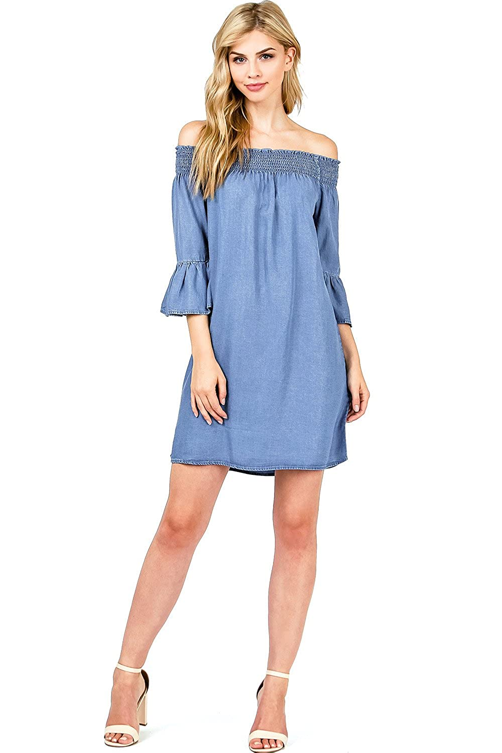 77e1ce3f0203 Chambray dress featuring a smocked off the shoulder neckline and trumpet  sleeves. Casual dress with a flirty flair
