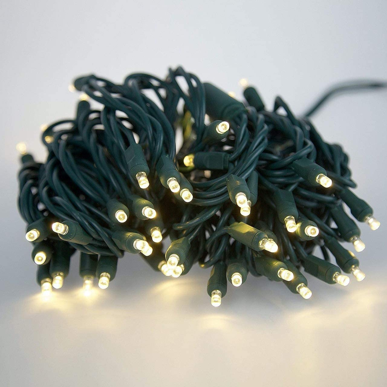 Christmas Twinkle Lights 20 of 100 Counts, for Outdoor Indoor, Commercial Grade, Warm White Light, Green Wire, 6in Spacing, 50ft, UL Listed