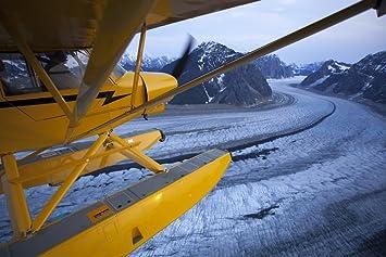 Amazon com: A Pilot Flies His Super Cub Floatplane Over The