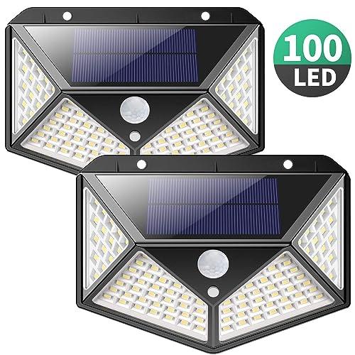 Luz Solar Exterior iPosible Versión Actualizada 100 LED Foco Solar con Sensor de Movimiento Gran Ángulo 270º Impermeable Inalámbrico Lámpara Solar 3 Modos Inteligentes para Jardín Garaje 2 Paquete