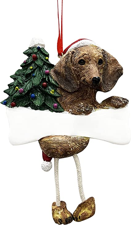 Hand painted dachshund puppy with a cute red scarf on a beautiful decorative plate.