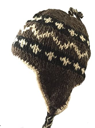8bfd0295781 Black  White Traditional Tibetan Design Earflap Hat - Fleece Lined for  Extra Warmth and Comfort - Fair Trade Hand Knitted 100% Wool  Amazon.co.uk   Clothing