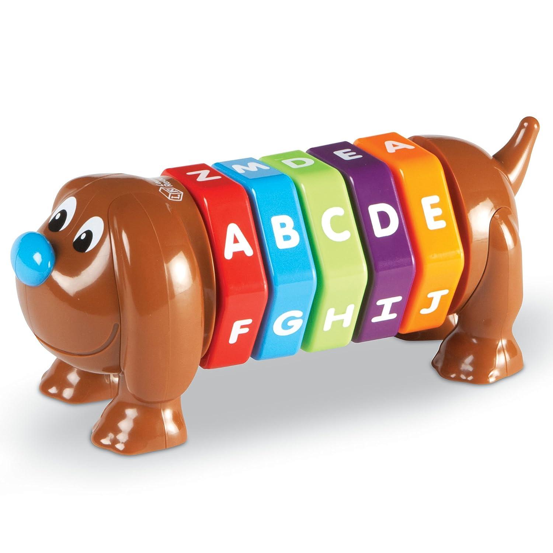 صور حروف للاطفال مدونه على لعبة شكل كلب