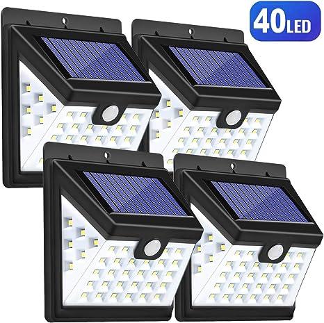 Luces Solares LED Exterior, Guenx Lámpara Solar con Sensor de Movimiento, Foco Solar de Pared para Jardín, Balcón, Garaje, Camino, Acera, 4 Piezas [Clase de eficiencia energética A]: Amazon.es: Iluminación