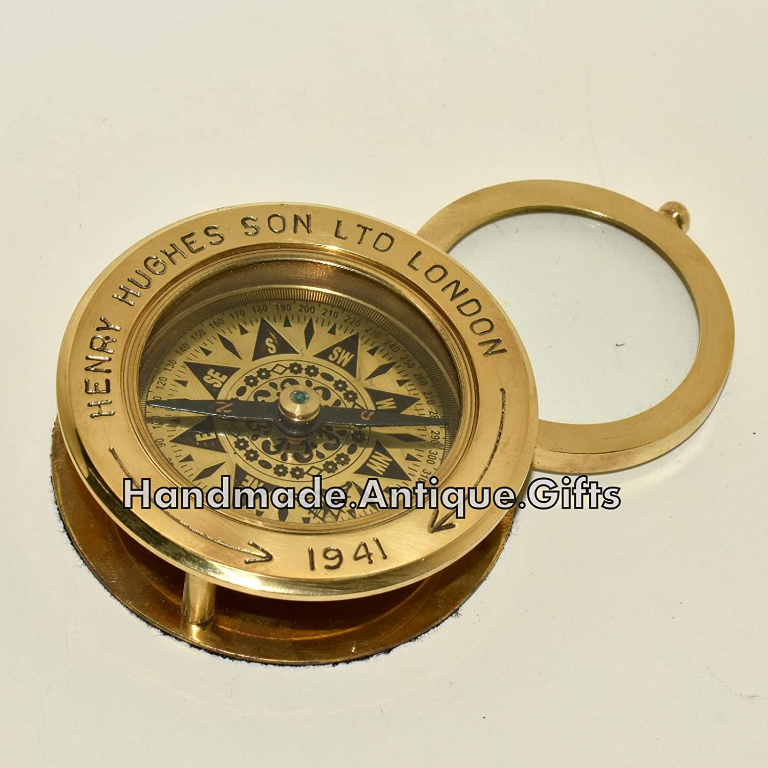 antique-nautical-brass-compass-flip-out-magnifying-glass-vintage-table-top-decor B0749HBVDP