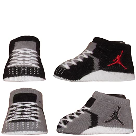 promo code 2d6cd c0915 Image Unavailable. Image not available for. Color  Nike Air Jordan Newborn  Infant Baby Booties Socks Black White Red Air Jordan Jumpman 23 Logo