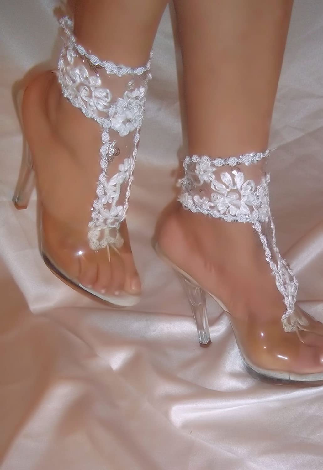 63af6593f1be0 Amazon.com  White Flower Barefoot Sandals