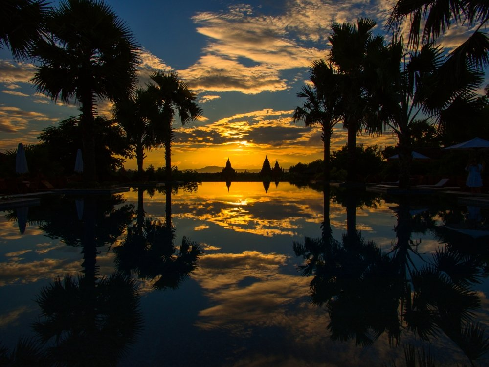 Sunset reflected in the infinity pool at Aureum Palace Hotel Bagan Mandalay Region Myanmar Poster Print by Panoramic Images 36 x 24