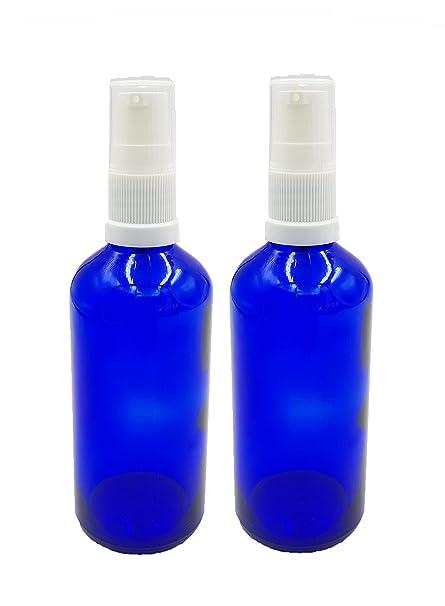 2 frascos de 100 ml en vidrio azul con tapa dosificadora blanca