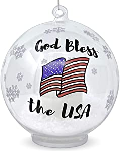 BANBERRY DESIGNS Patriotic Christmas Ornament – Glass Ball Ornament with God Bless The USA – Light Up Ornament with a LED Candle and Artificial Snow Inside – Red White and Blue American Flag Design