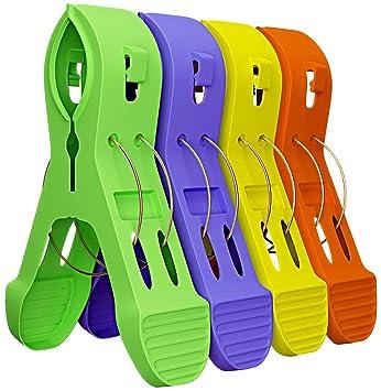 Juego de 12 clips para toallas de playa, para sillas, toalleros en colores divertidos y brillantes - evita que las toallas se salgan: Amazon.es: Hogar