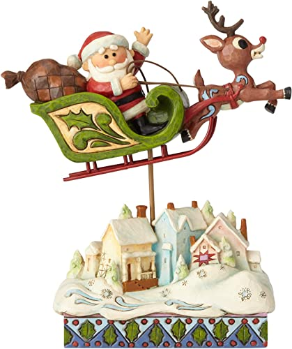 Enesco Rudolph The Red Nosed Reindeer by Jim Shore Sleigh Over Village Figurine, 7.2 , Multicolor