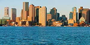 Panoramic of Boston Harbor and the Boston skyline at sunrise as seen from South Boston Massachusetts New England Poster Print by Panoramic Images (12 x 6)
