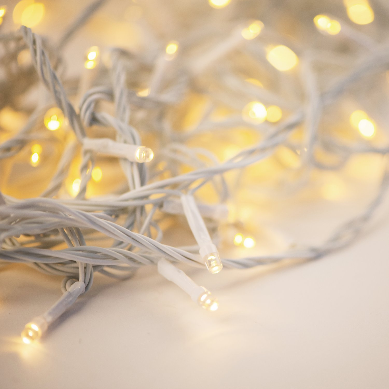White String Lights with 200 LEDs, 66 ft, Warm White Glow, Indoor/Outdoor Use, 8 Light Functions, Battery-Operated, Connectable, UL Listed - For Home, Patio and Party Decorations