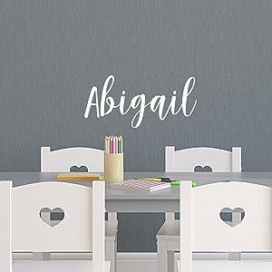 "Vinyl Wall Art Decal Girls Name - 'Abigail' - 12"" x 28"" - Girls Bedroom Vinyl Wall Decals - Cute Wall Art Decals for Baby Girl Nursery Room Decor (12"" x 28"", White Cursive)"