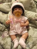 she is happy with her baby doll and i too