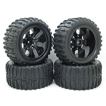4 x RC 1: 10 Off-Road coche negro neumático de ruedas de caucho y plástico 7 radios Llantas para Monster Truck Bigfoot: Amazon.es: Juguetes y juegos