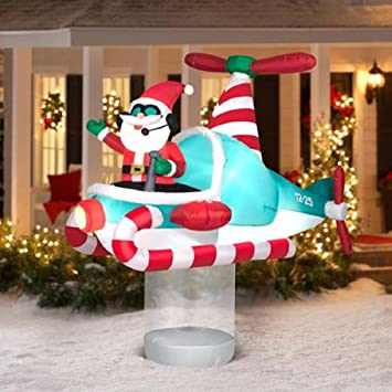 Amazon.com : Christmas Inflatable 7' Santa In Hovering Candy Cane ...