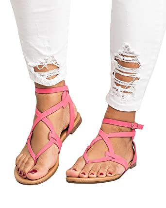 1ef8deae4db2 Amazon.com  Pxmoda Womens Cute Criss Cross Strappy Flat Sandals Summer  Beach Flip Flop Flats Gladiator  Clothing