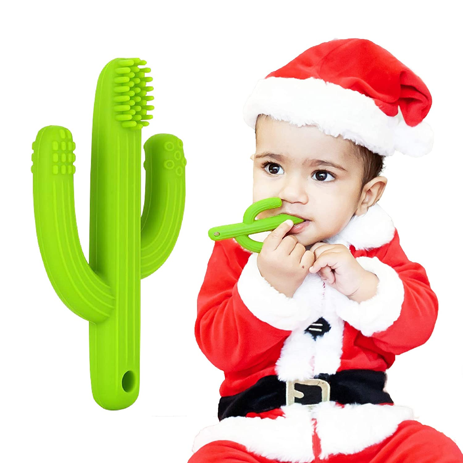 baby in santa outfit with cactus shaped teething toothbrush