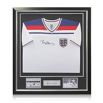 exclusivememorabilia.com Camiseta de fútbol de Inglaterra firmada por Bryan Robson. En marco de