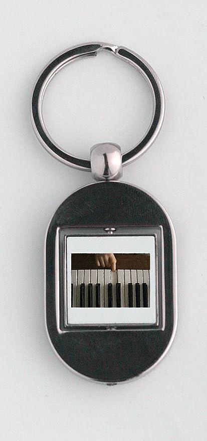 Un niño Pulsar una nota sobre un piano llavero: Amazon.es: Hogar
