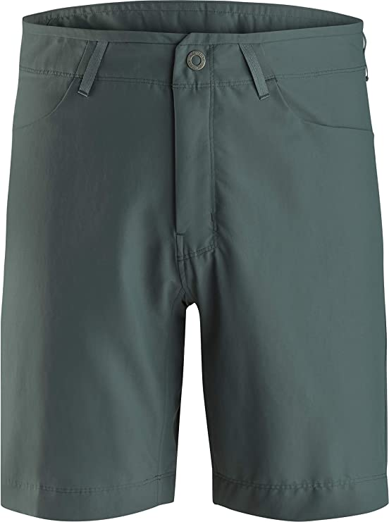 Image of a hiking short in dark moss green color, button and two side pockets are seen.