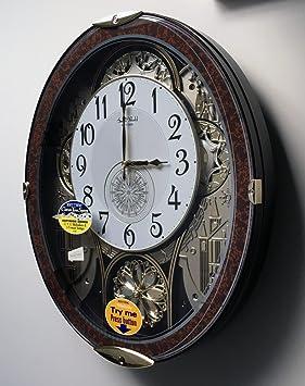 trendy cadran rotatif rhythm petit monde musical horloge murale avec swarovski elements with. Black Bedroom Furniture Sets. Home Design Ideas