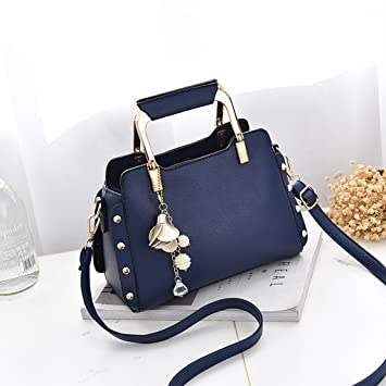 4ac52cb39a89 Amazon.com   Female bag small party bag hand rivet bag mini Messenger bag  shoulder bag (Color   Blue