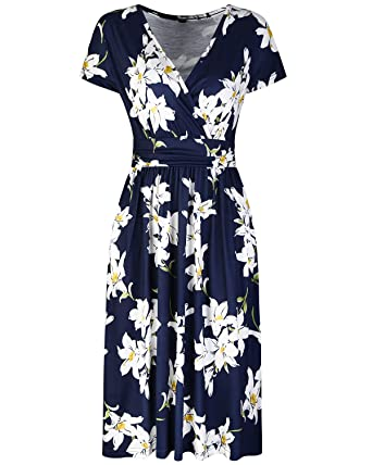 94759d1cf26 OUGES Women s Summer Short Sleeve V-Neck Pattern Knee Length Dress with  Pockets at Amazon Women s Clothing store