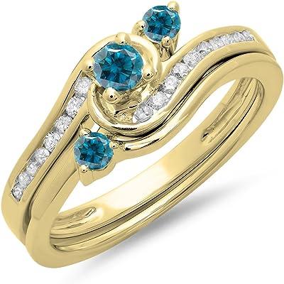 anillo de oro amarillo con diamantes azules