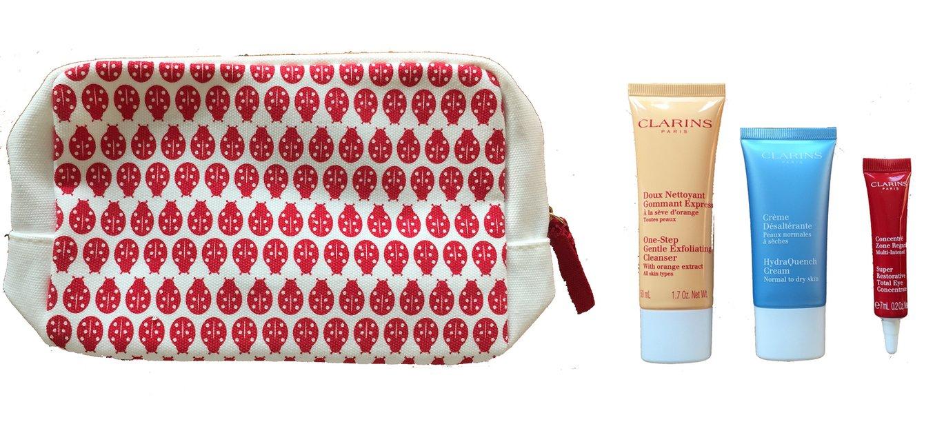 Clarins Estuche de regalo y bolsa de viaje (limpiador, crema ...